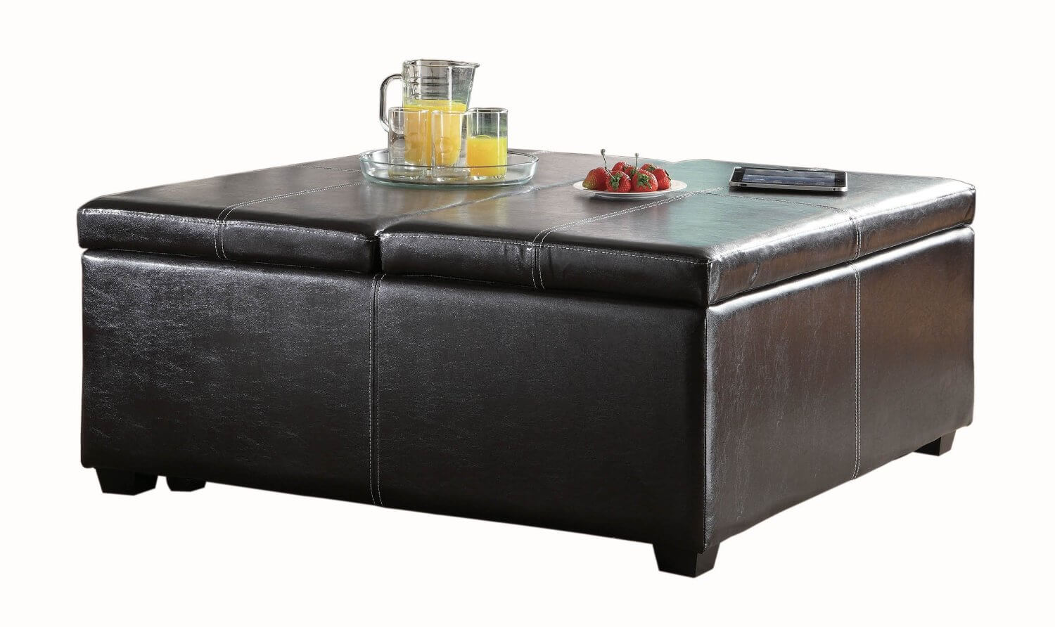 Brown leatherette ottoman features both lift-top lid on one side, for convenient reading or dining, and flip-top lid for storage access on opposite side.