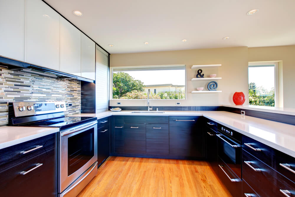 Large U-shaped kitchen with black lower cabinetry