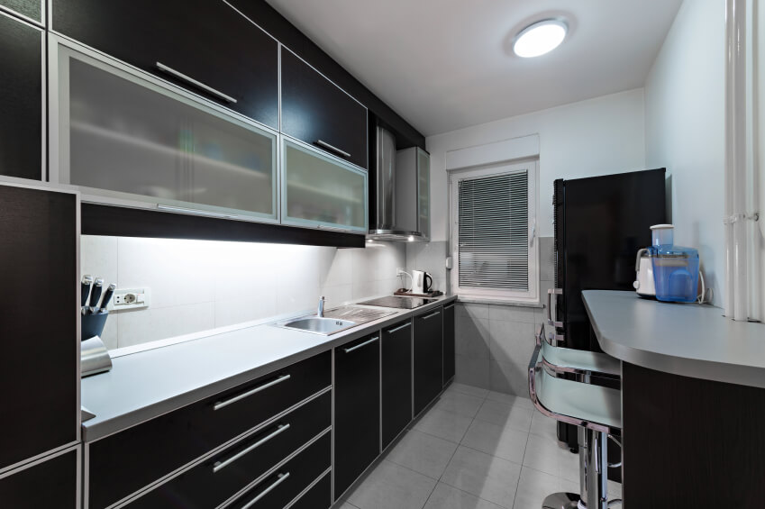 Small kitchen with black cabinets throughout.