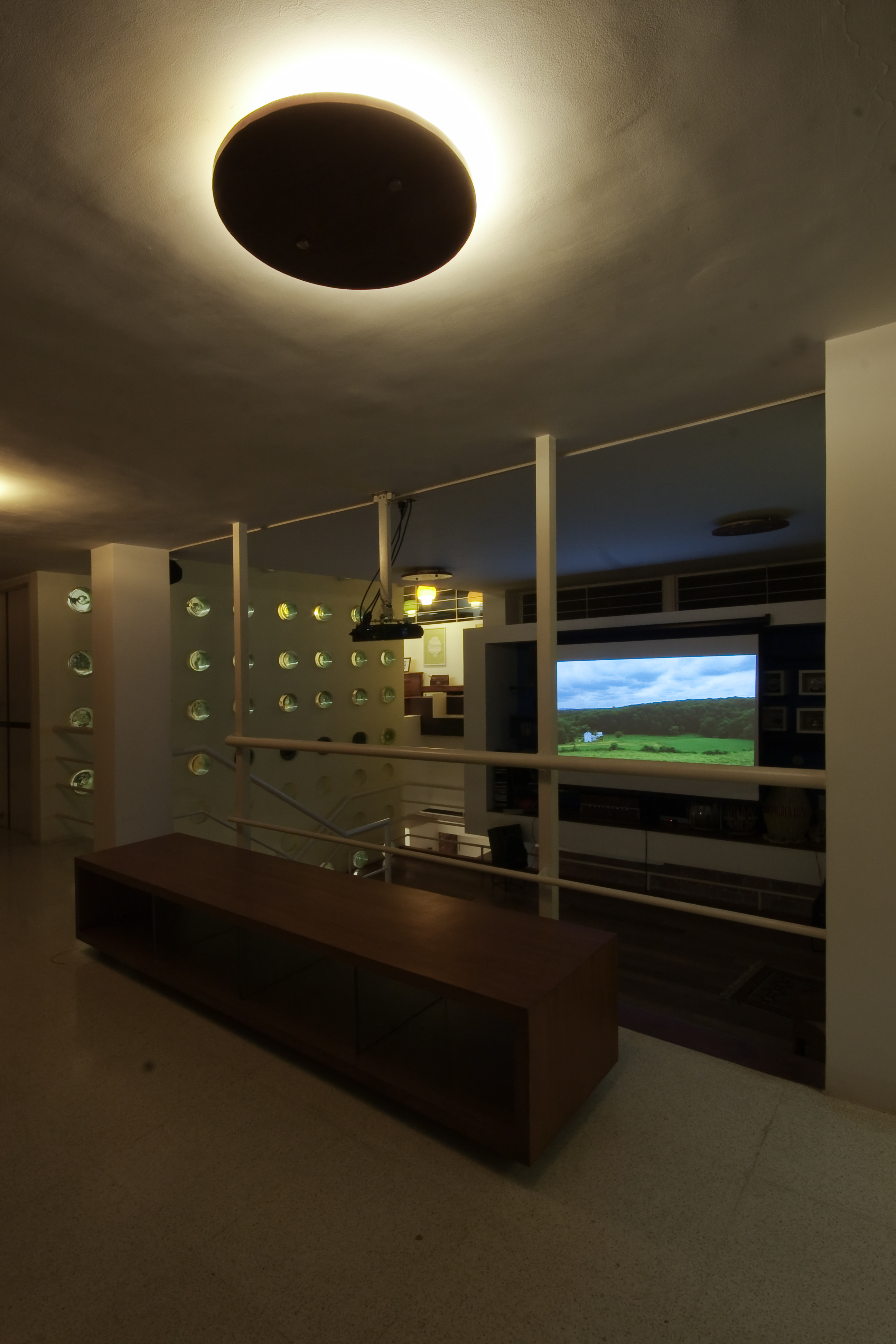 When darkness falls, a large screen can be lowered in the central living room for movie time.