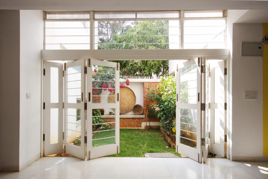 The lower level features another sliding panel glass opening to this small garden area behind the main brick wall.