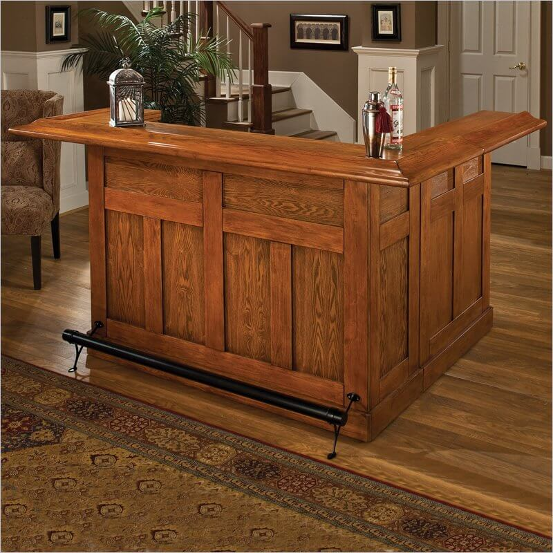 Here's a large L-shaped oak home bar with a good mix of open and closed storage.