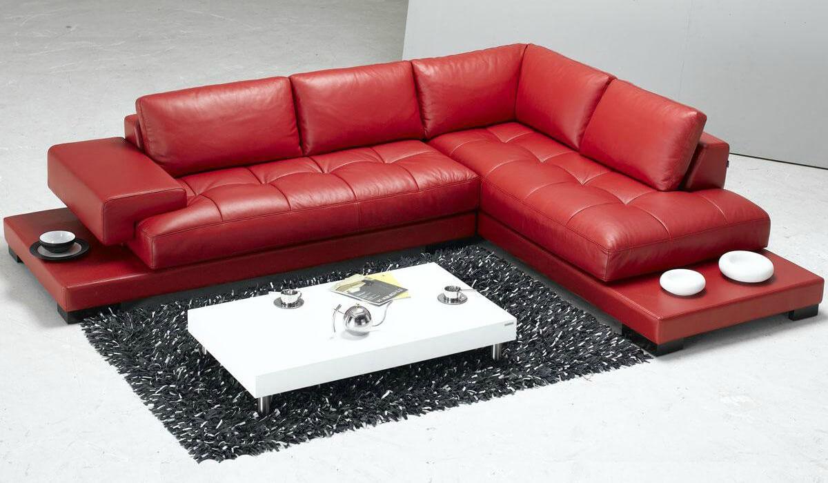 This is a very popular red modern sectional. It includes an arm on one side. Each side includes a small platform table at the ends for placing drinks and/or decorative objects.
