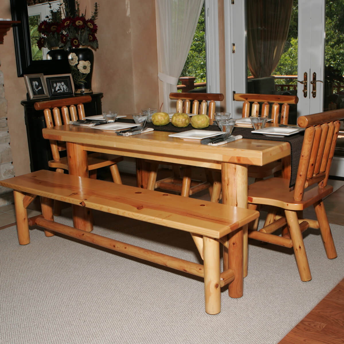 Here's a dining table set with bench perfect for the log cabin or home. Seating 8 people, it's great for large gatherings. It's constructed of white cedar and pine with a truly natural wood look.
