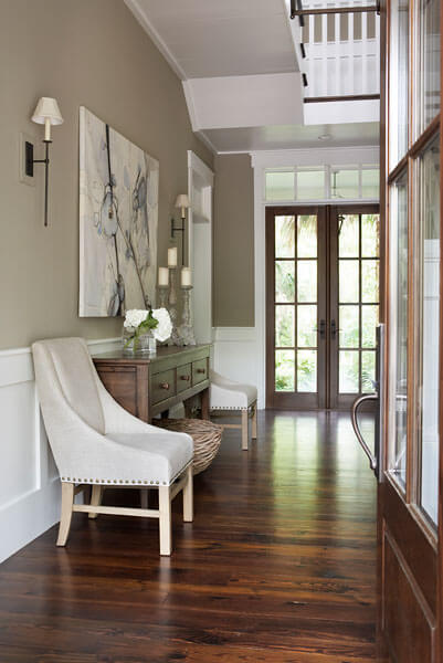 Main hallway is decked out in rich, dark natural hardwood, with light beige and white walls for subtle appearance, giving way to the natural beauty around.