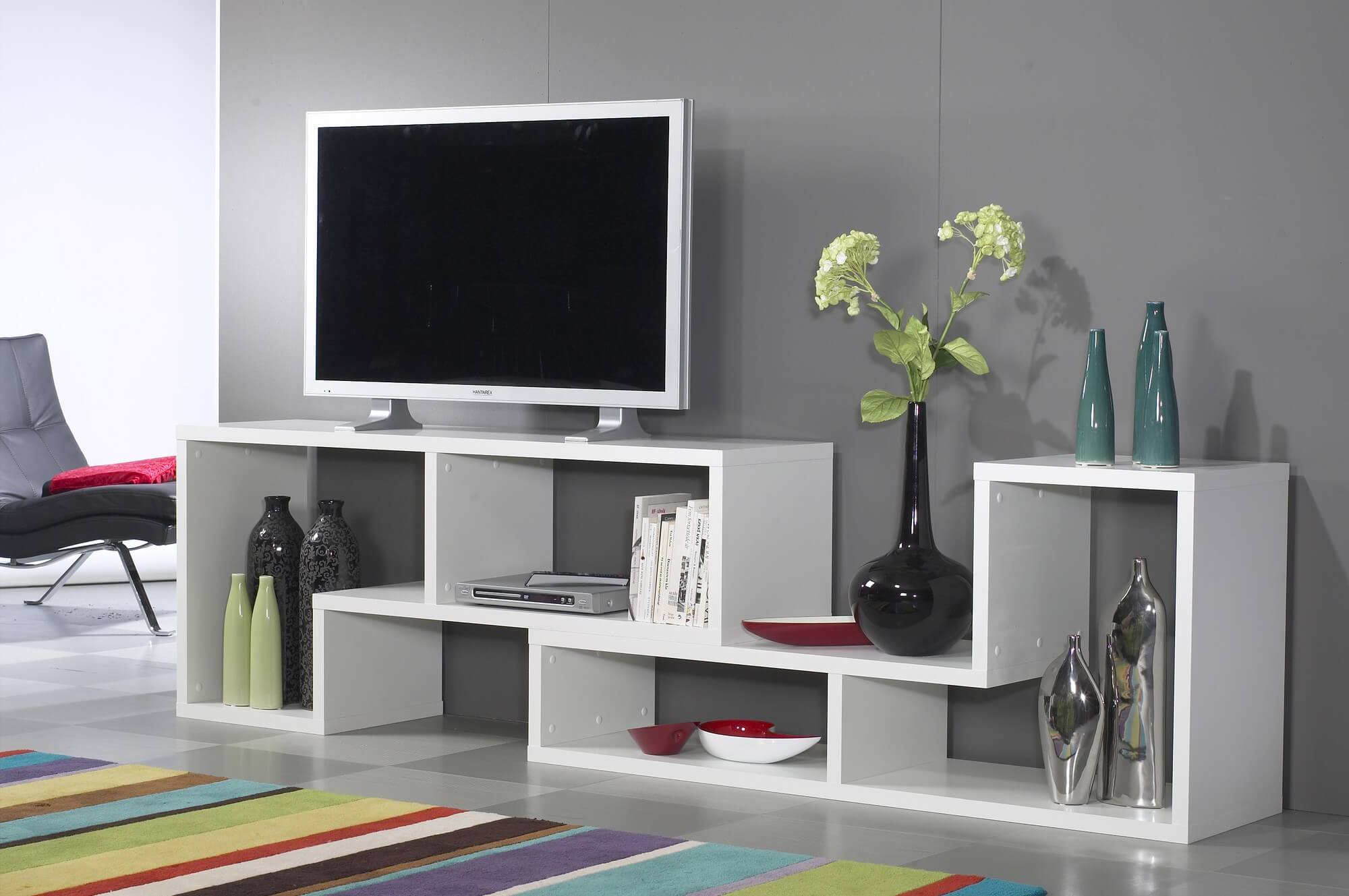 This is a horizontally oriented modern 6-cube shelving unit that as you can see is ideally suited as an entertainment stand offering additional storage sections for books, CDs, etc.