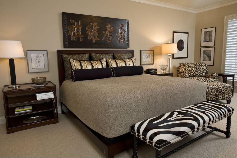 This is an interesting example because the room is in earth tones predominately with the zebra print ottoman veering from the browns.