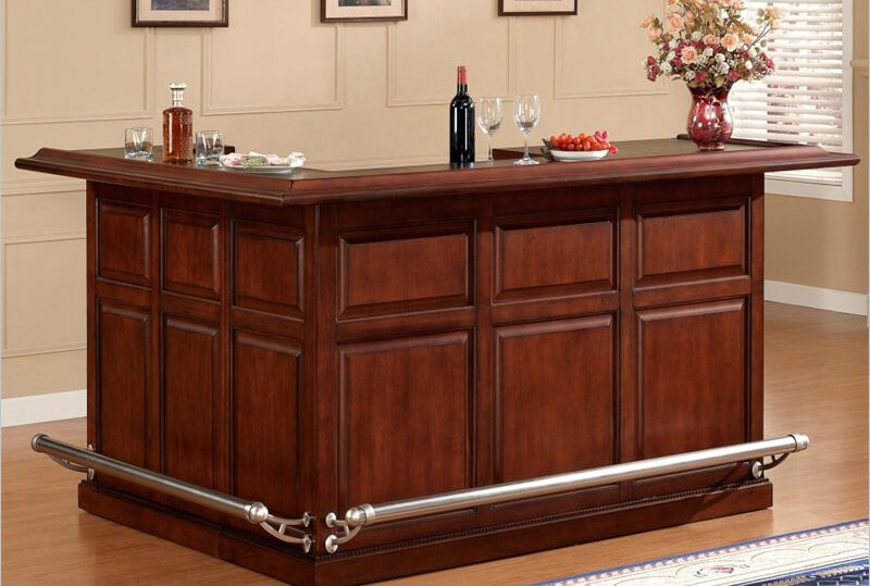The L-shape home bar cabinet creates extensive storage with some open shelving and some closed storage.