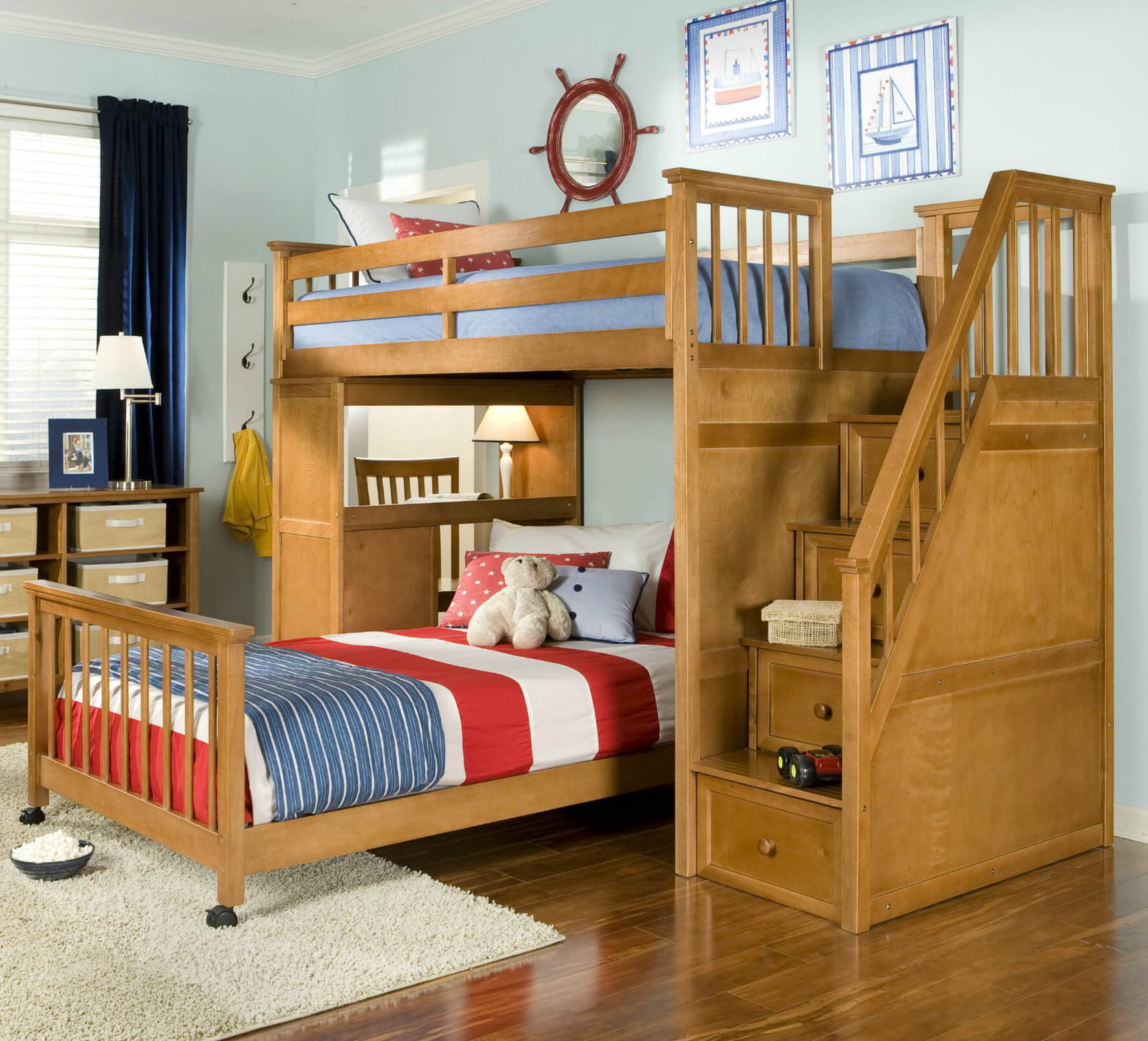 Pecan hardwood L-shaped bed includes a staircase and desk. Lower bed (can be twin or full) is on wheels and is separate from the upper bed and storage. Staircase includes drawer storage (very clever design).