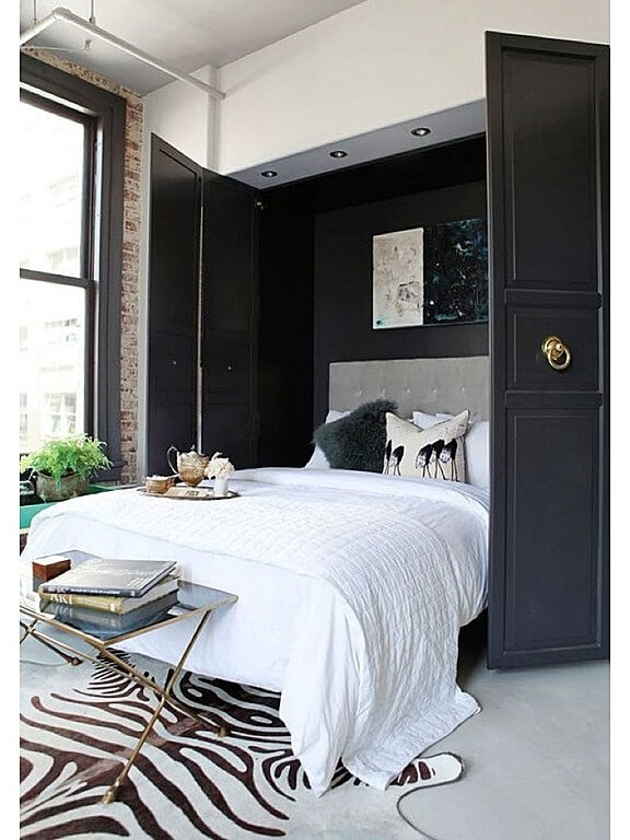 Here's a Murphy style bed with dark grey doors that blends well with the zebra print rug situated at the end of the bed.