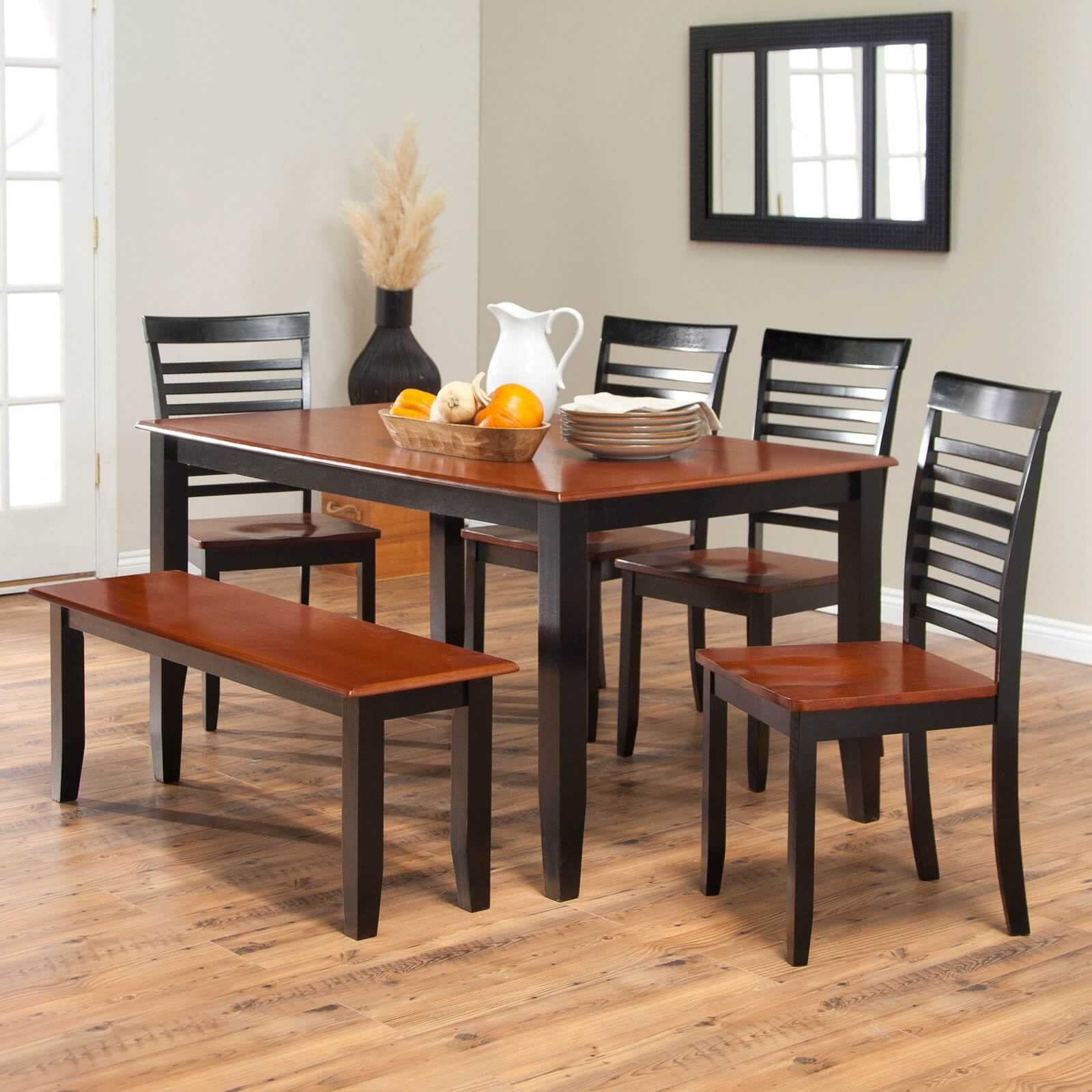Simple two-toned dining set with bench. The seats and table top are cherry finish; the legs and chair backs are a black finish.