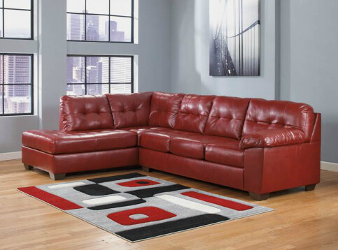 This is a deep red leather sectional designed for comfort in a contemporary design. It offers a high back and firm cushioning. It's a 2-piece sectional.