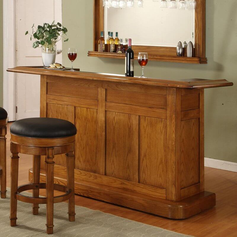 This oak felt-lined drawer home bar includes plenty of bottle storage as well as a stainless steel dry sink.