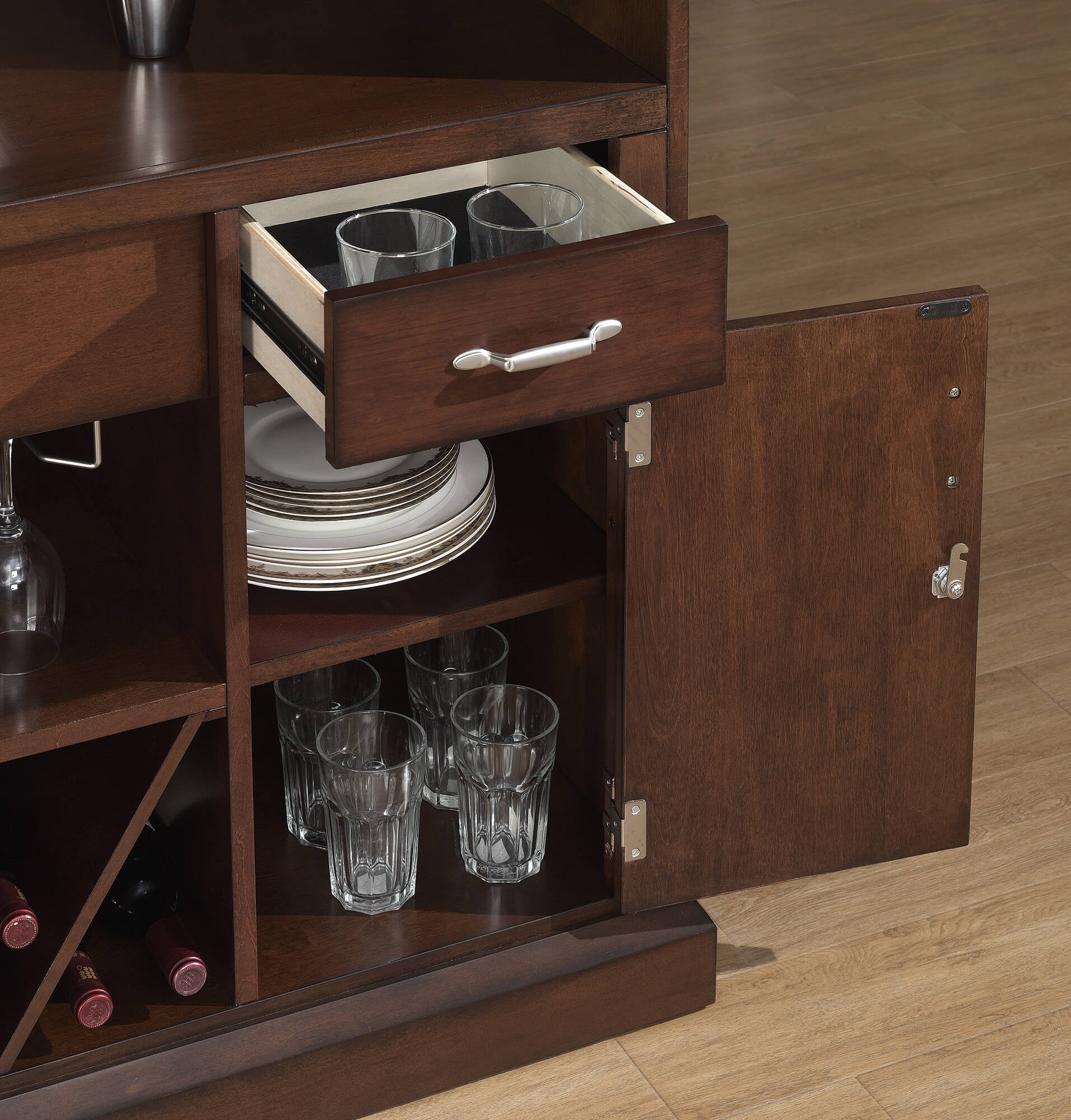 Behind the bar view - This is a beautiful home bar unit with sturdy foot railing, extensive storage including a wine rack and locking storage, and sturdy construction.