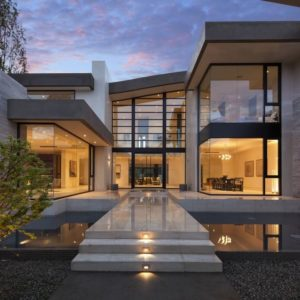 Curb view of magnifcent San Vincente House by McClean Designs