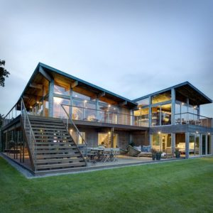 Dusk Panoramic View of 2-story Glass Home