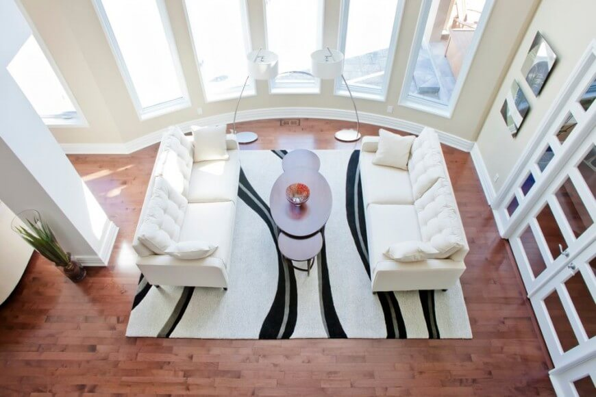 Aerial view of the 2-story living room of the Hudson Residence by Rebecca Mitchell Interiors.