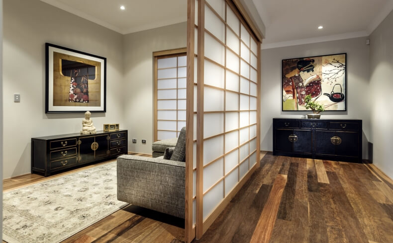 Central hall features more dividing shoji screens, with matching dark wood cabinetry sets bringing cohesive touch to different spaces. Traditional Japanese art adorns the walls.