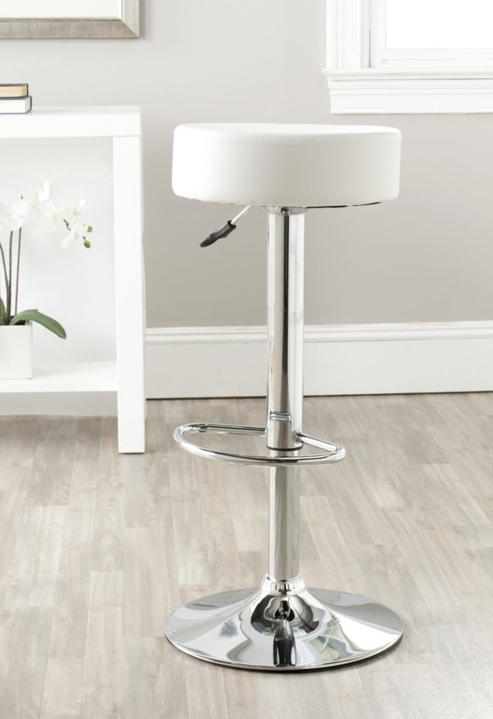 This inexpensive modern stool is a basic design with round seat and no back. The seat is upholstered in faux leather. The stool swivels 360 degrees and adjusts up and down.