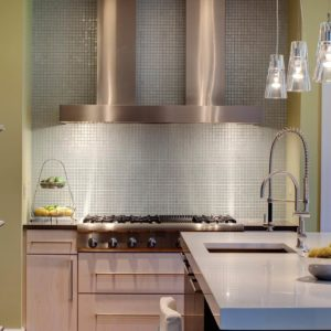 Contemporary kitchen with soft light and colors by Drury Design