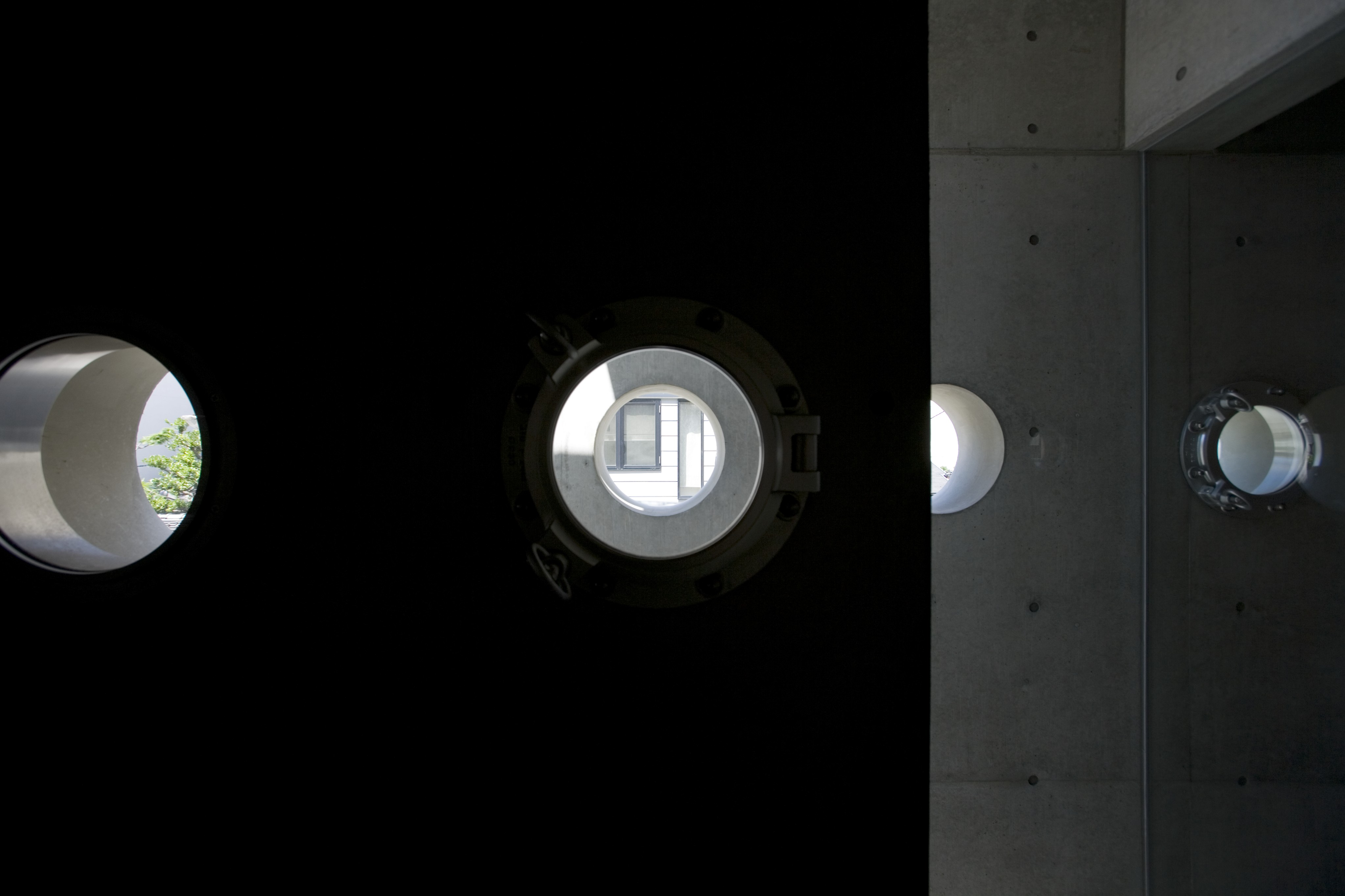 The layers of holes allow, as per the designer's intent, a series of dramatic shafts of light entering the home throughout its length.
