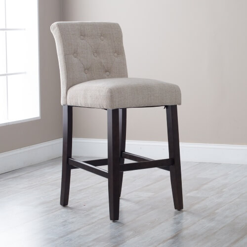 4-legged wood-framed armless stool with off-white upholstered seat and back.