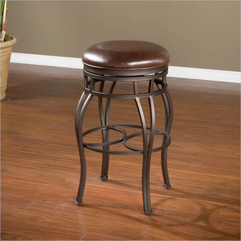 Backless stool with 4 ornate legs in the traditional style with cushioned round seat.