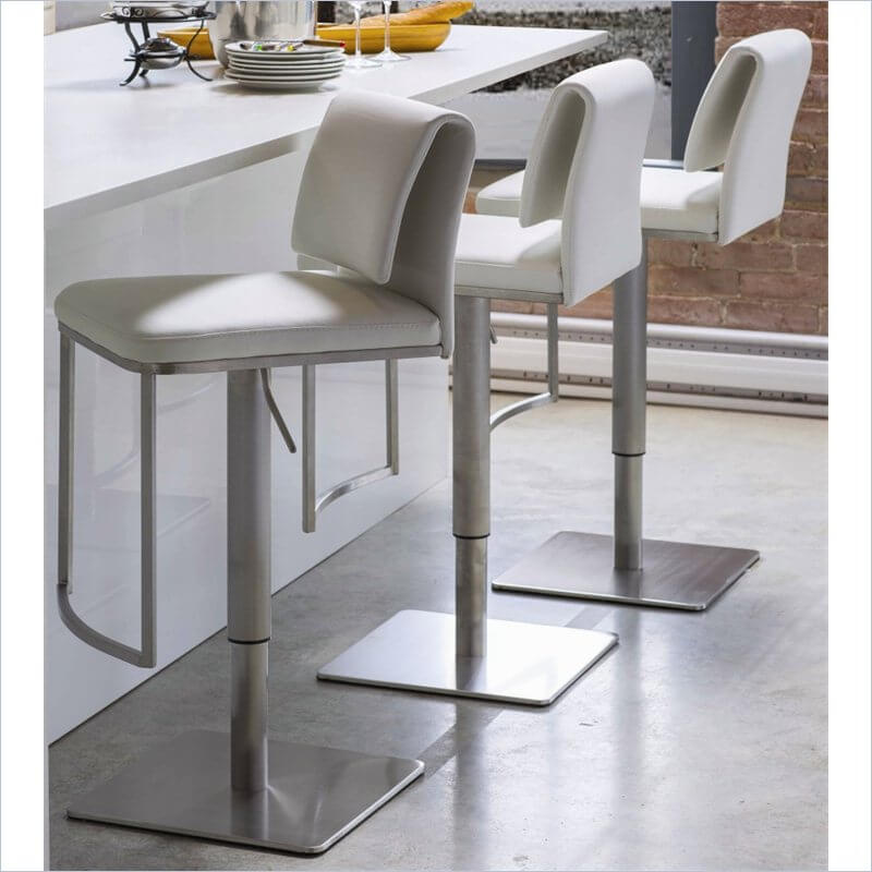 These square off-white modern stools provide a foot rest and adjust up and down with a hydraulic lift. The upholstery is leather.