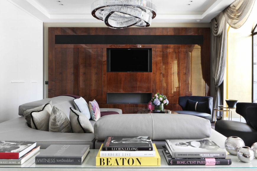 White and gray living room with wood-paneled wall.