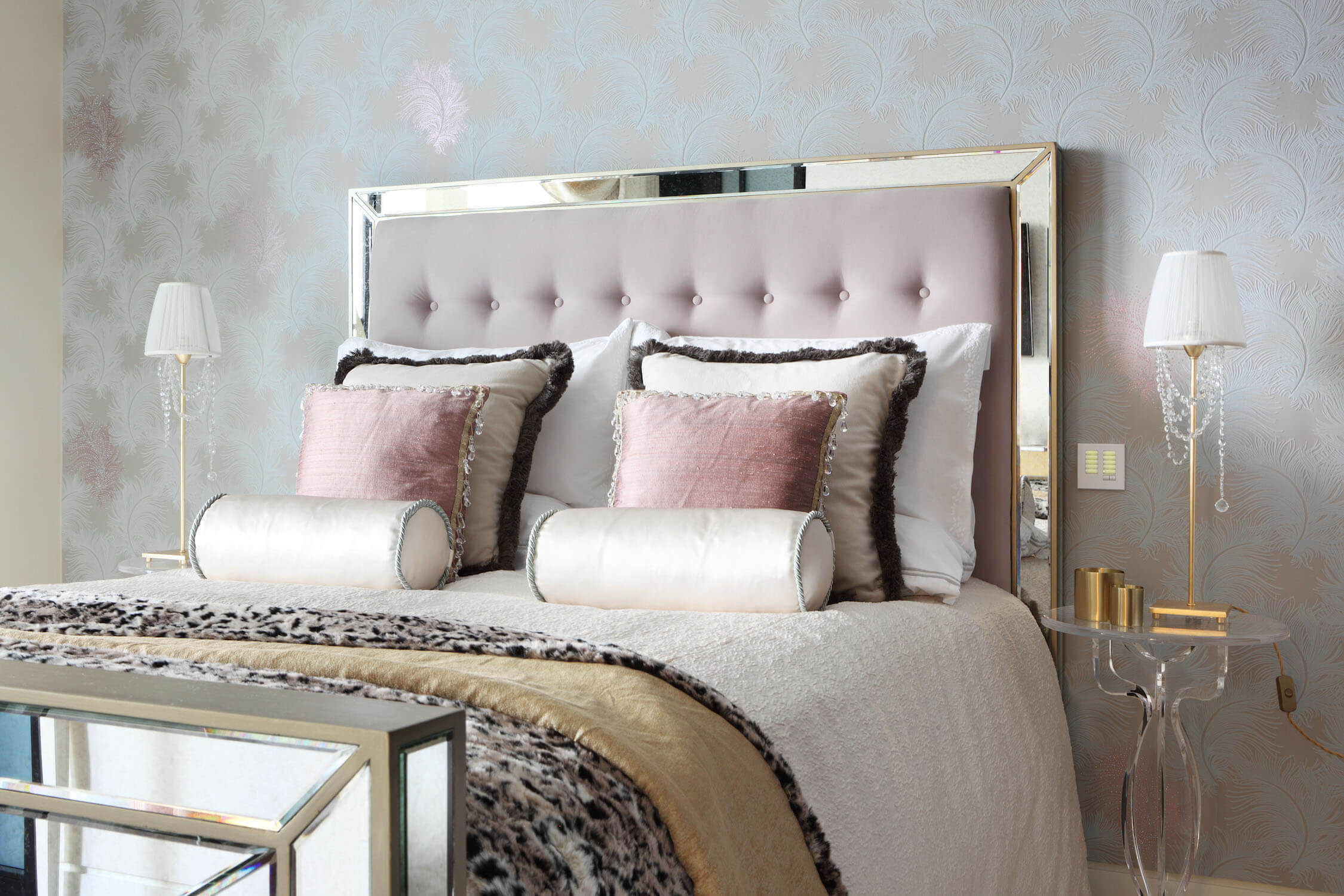This light, feminine bedroom is enhanced by a soft colour palette and a discreet flock wallpaper with Swarovski elements that reflects light throughout the room.