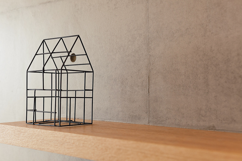This metal house sculpture compliments the naturally minimalist style governing the home.