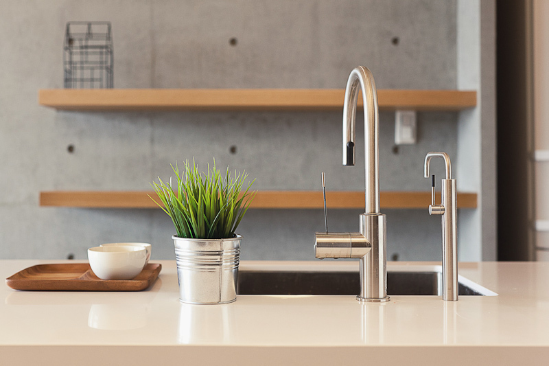 Simple, direct design informs the faucets, complimenting the minimalist theme and contrasting with natural wood tones throughout the home.
