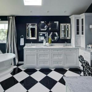Striking blue and white primary bathroom by Drury Design