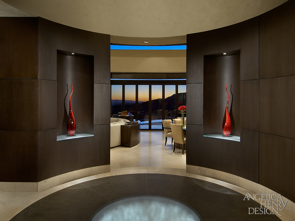 Foyer features this unique floor, holding a cast glass slab with fiber optic lighting below, surrounded by granite slabs on a limestone floor.