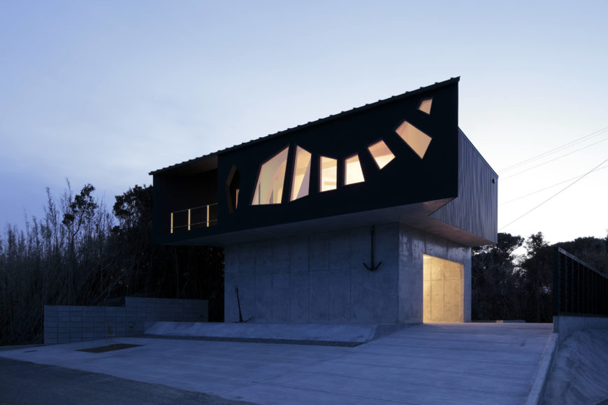 Here we see the concrete structure and black home body illuminated from within.