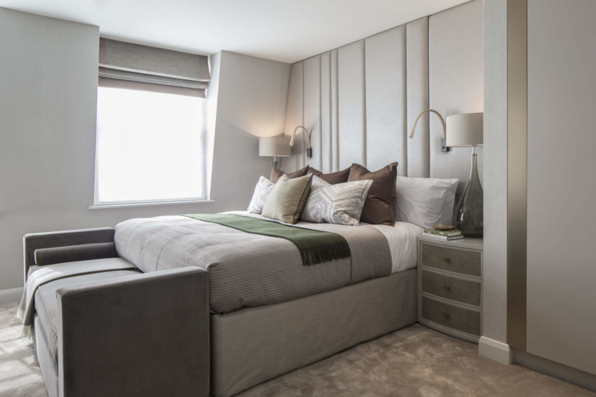 With intricate wall details, like the folded leather bed backing, and metallic strips flanking the closet doors, the entire home is flush with surprising detail.