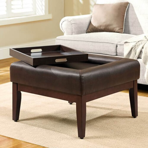 Brown leather ottoman coffee table.