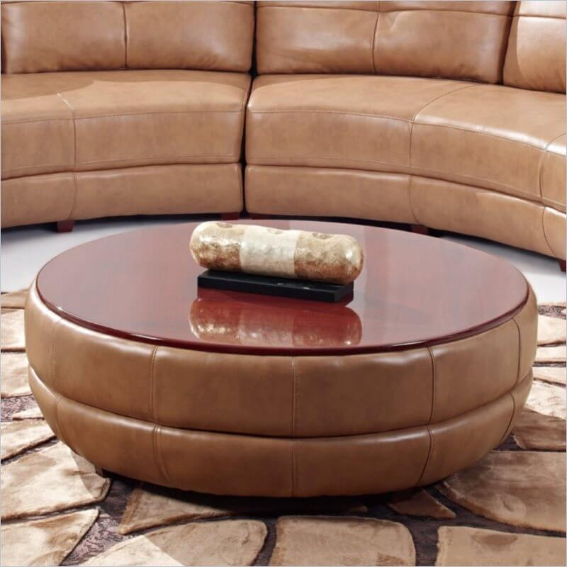 This breed of ottoman is also known as the coffee table ottoman. The standout feature is a more table-like top upon which drinks and food can be placed. Some models will have a reversible cushion top, with a solid table on the other side, while others have treys that fit perfectly upon the surface.