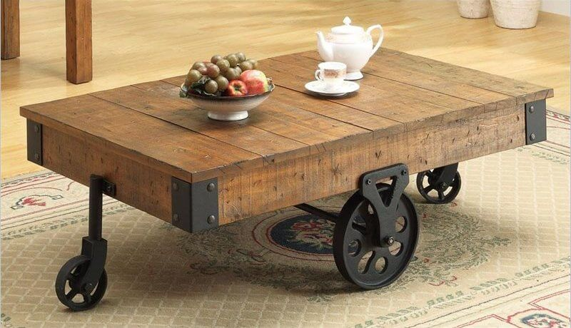 Novelty is another wildly broad term within the realm of style. These tables can take the form of anything from a glass pyramid to football themed pieces. The defining characteristic is that the table has a notable element defining it, outside of the actual material and shape itself. For our example, we chose this wheeled-cart style table.