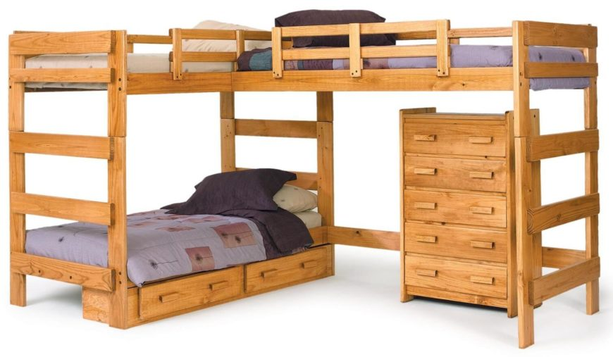 As the name implies, a triple bunk bed has sleeping space for three. Some configurations stack them vertically, which works if you have ample headroom and high ceilings in your home. Most examples spread the beds around, with either an added trundle or like this L-shaped configuration.