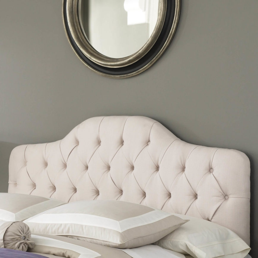 Upholstered headboards add a soft, luxurious, and decorative touch.