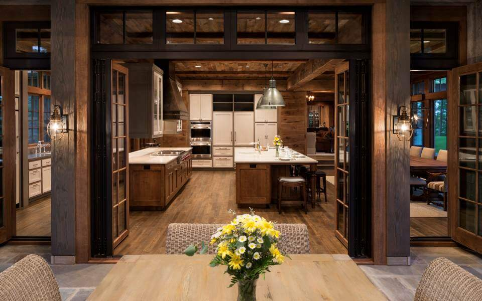 With twin standard size wood-frame, glass panel doors allowing entry to and from the kitchen and dining spaces, the main folding-door passage can be left closed to conserve warm or cool air.