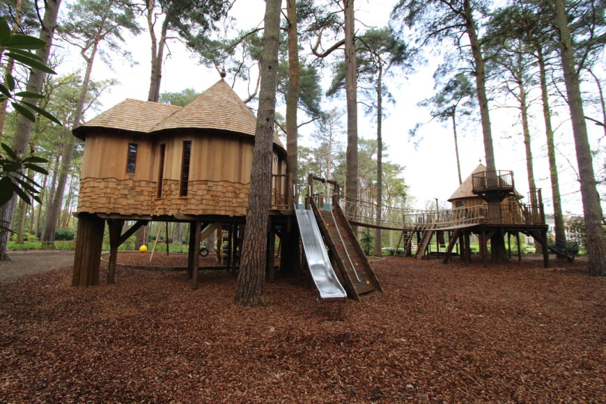Another view of the second treehouse shows the crow's nest on the other side of the rope bridge.
