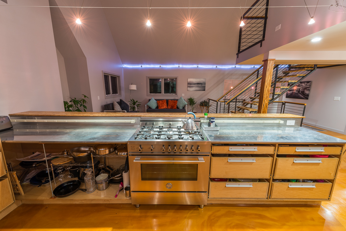 From the stove, the living room is easily visible, and a raised bar adds extra seating and an eat-in kitchen.