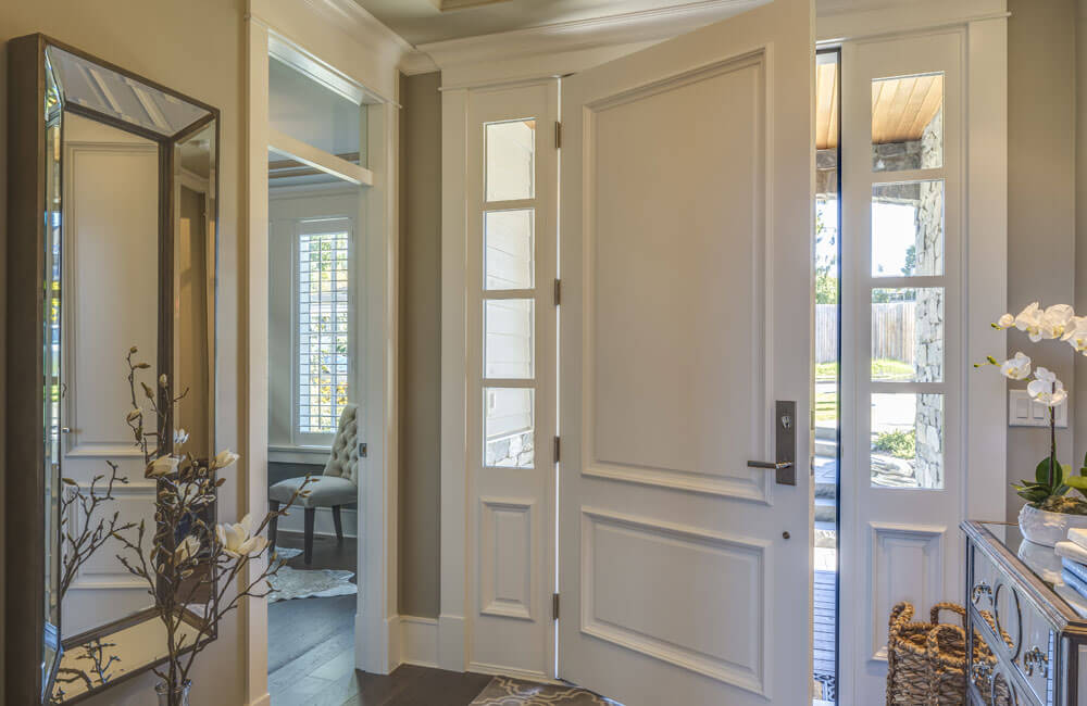 A small foyer leads into the room to the left, a home office, and back to the main living area.