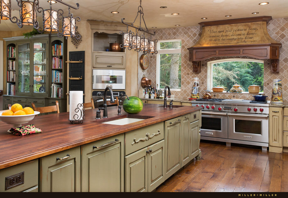 The massive Italian country kitchen has plenty of workspace and wood countertops. The long island contains two sinks.