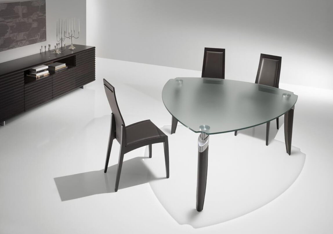 Our second freeform example stands a rounded triangle shape in contemporary glass and metal construction, with lengthy sides for two diners each.