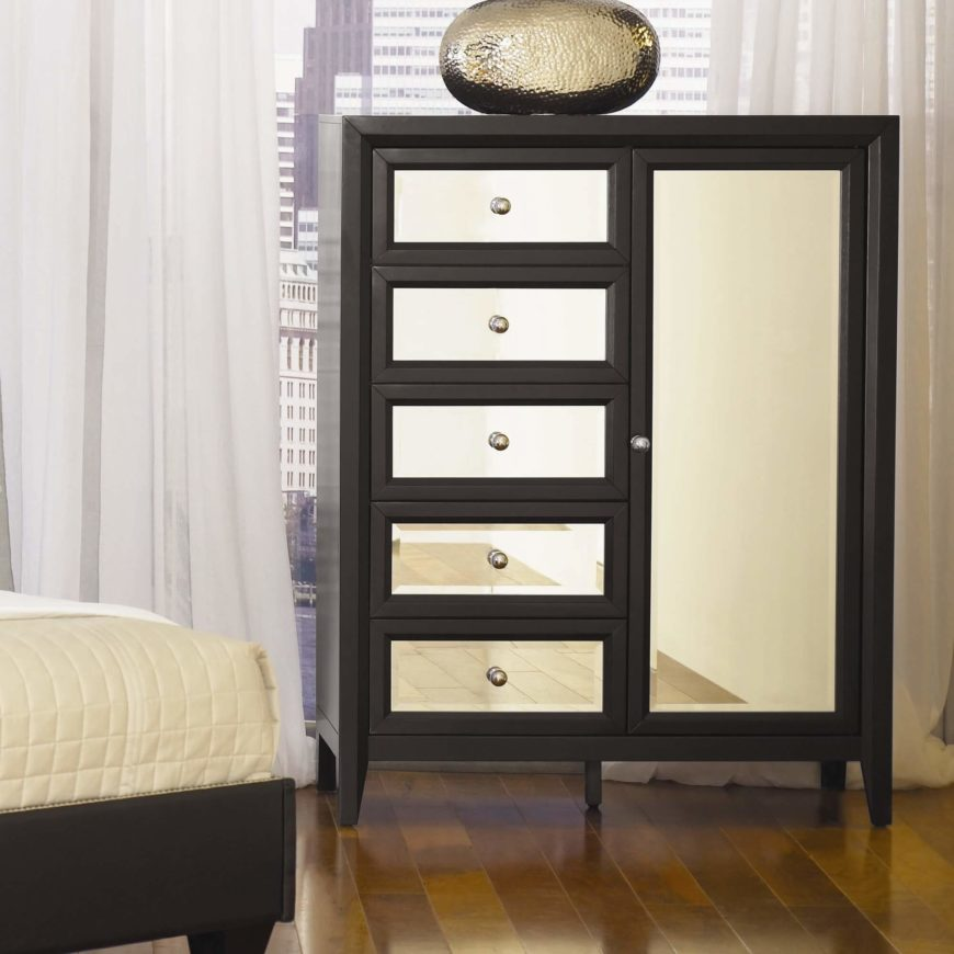 The gentlemen's chest is a configuration wherein the drawer column is paired with a large vertically oriented cabinet door. This holds a large cavity where hung suits, pants, and other clothing may be stored.
