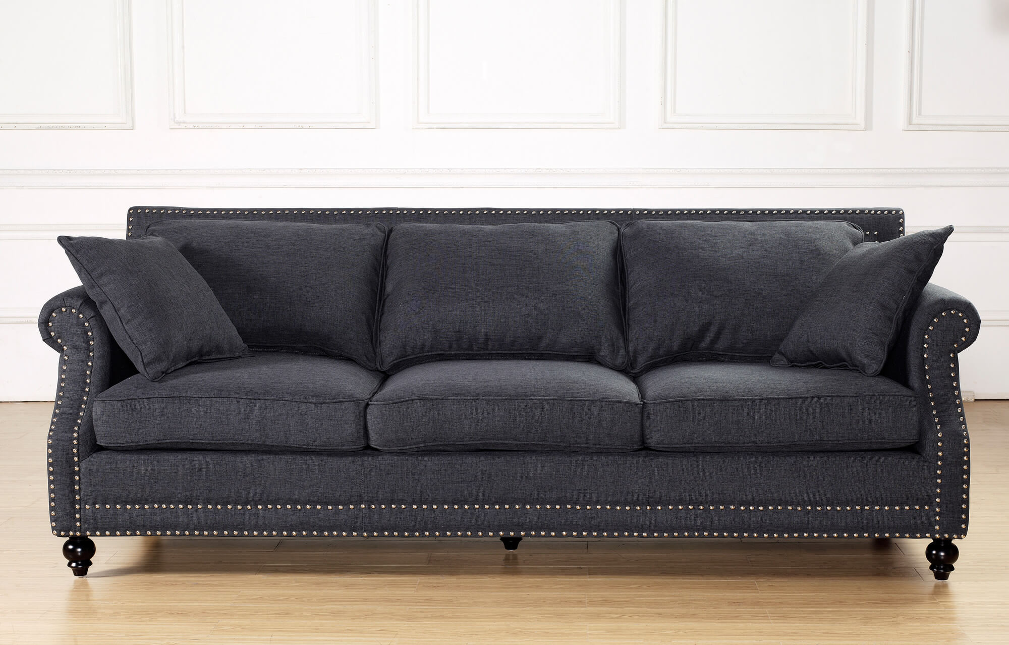 This very contemporary sofa in a deep charcoal linen is detailed with a copper nail trim. The birch frame and legs are painted black to keep with a contemporary style. The high backrest and reposition-able cushions make this sofa an ultra-comfortable and plush option with a ton of style.