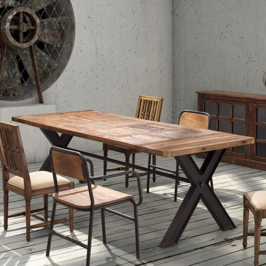 Industrial style is meant to convey the look and feel of factory machinery and tools, with naked metal and bold, strong wood shapes paired into a purposeful look. Our example table features a crossed I-beam frame and natural hardwood tabletop.